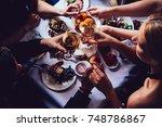 glasses of white wine seen... | Shutterstock . vector #748786867