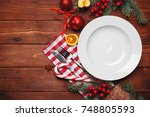 christmas table place setting | Shutterstock . vector #748805593