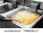 fryer with french fries  close... | Shutterstock . vector #748828117