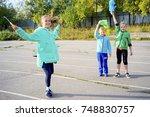 kids on a stadium | Shutterstock . vector #748830757