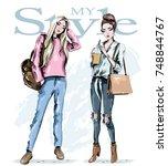 two fashion girls. hand drawn... | Shutterstock .eps vector #748844767