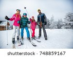 winter time and skiing   happy... | Shutterstock . vector #748859167