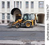 Small photo of MOSCOW, RUSSIA - CIRCA OCTOBER, 2017: Workers make a ditch with an excavator to replace the curb of the sidewalk. Malaya Ordynka street.