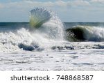 Small photo of This amazing backwash from the surf of a wave displays its awesome fan formation in the ocean of the Outer Banks of North Carolina.