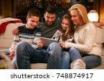 happy family together looking... | Shutterstock . vector #748874917