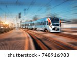 high speed train arrives on the ... | Shutterstock . vector #748916983