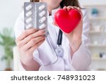 doctor cardiologist with red... | Shutterstock . vector #748931023