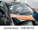 male specialist with car... | Shutterstock . vector #748938793