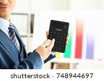 male arm in suit hold...   Shutterstock . vector #748944697
