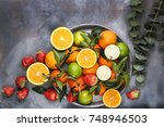 assorted fruits on a gray... | Shutterstock . vector #748946503