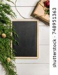 fir branches border and black... | Shutterstock . vector #748951363