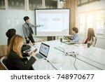 businessman standing in front...   Shutterstock . vector #748970677