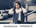 sad young fashion woman walking ... | Shutterstock . vector #749004673