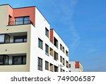 modern apartment buildings on a ... | Shutterstock . vector #749006587