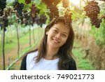 asian woman smile and bunch of ... | Shutterstock . vector #749021773