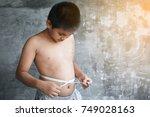 portrait asian fat boy concept... | Shutterstock . vector #749028163