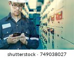 double exposure of  engineer or ... | Shutterstock . vector #749038027