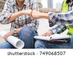 colleague greeting teamwork... | Shutterstock . vector #749068507
