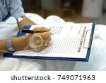 insurance claim form put on... | Shutterstock . vector #749071963