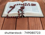 bible crucifix and beads on a...   Shutterstock . vector #749080723