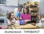 grandmother and granddaughters... | Shutterstock . vector #749086927