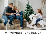 young happy family of four near ... | Shutterstock . vector #749103277
