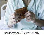 woman sick sit on patient bed... | Shutterstock . vector #749108287