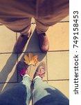 couple enjoying outdoors.... | Shutterstock . vector #749158453
