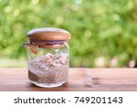 seashells and sand in glass jar ... | Shutterstock . vector #749201143