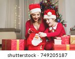 cute girl and her mother on a... | Shutterstock . vector #749205187