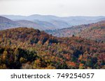 Small photo of Spectacular scenic aerial view looking at the colorful fall colors in the Quebec Laurentian mountains region, Canada.