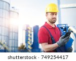 worker using mobile phone... | Shutterstock . vector #749254417