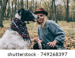 woman and dog | Shutterstock . vector #749268397