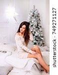 a charming brunette fixes her... | Shutterstock . vector #749271127