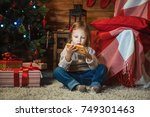 little girl with smartphone at... | Shutterstock . vector #749301463