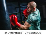 man on boxing training | Shutterstock . vector #749305003