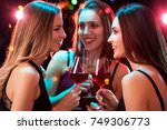 happy young women with glasses... | Shutterstock . vector #749306773
