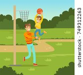 father playing basketball with...   Shutterstock .eps vector #749312263