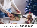 woman wrapping christmas gift | Shutterstock . vector #749325433