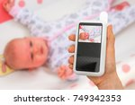 hand of mother is holding baby... | Shutterstock . vector #749342353