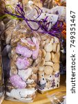 Small photo of Image of two packs of festive alsatian biscuits on a table in a winter Christmas market.
