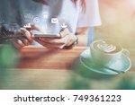 women using a smartphone in the ... | Shutterstock . vector #749361223