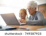 little girl with grandmother... | Shutterstock . vector #749387923