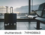 two travel suitcases in airport ... | Shutterstock . vector #749408863