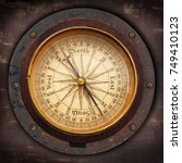 old compass on vintage... | Shutterstock . vector #749410123