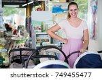 smiling pregnant woman choosing ...   Shutterstock . vector #749455477