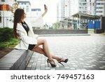 beautiful young fashionable... | Shutterstock . vector #749457163
