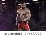 handsome man with big muscles ... | Shutterstock . vector #749477737