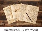 pile of old vintage manuscripts ... | Shutterstock . vector #749479903