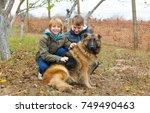 boys with german shepherd | Shutterstock . vector #749490463